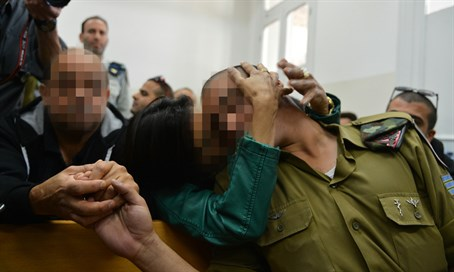 Hevron soldier with his parents in court