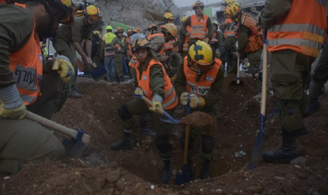 Rescue workers dig through rubble at collapsed parking garage