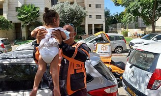 Emergency responder rescues baby locked in hot car in Petah Tikva