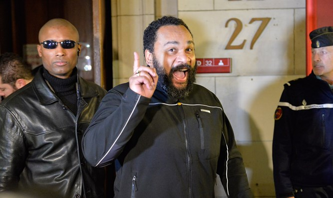 Dieudonne M'bala M'bala leaving a Paris courthouse, Feb. 4, 2015