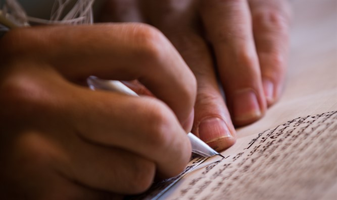 Scribe writes a Torah scroll