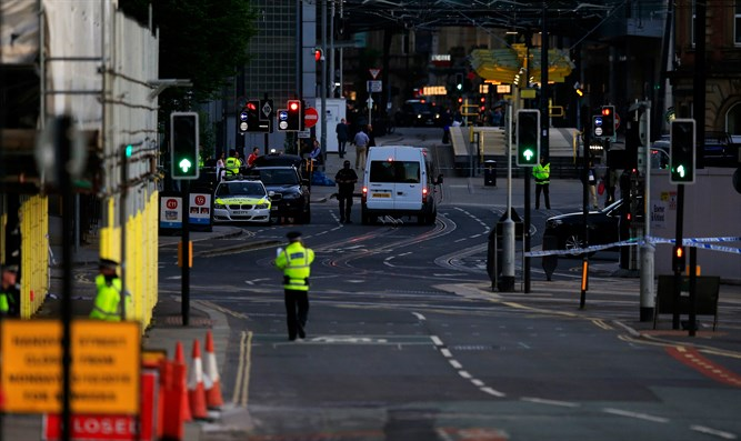 Police patrol outside the Manchester Arena