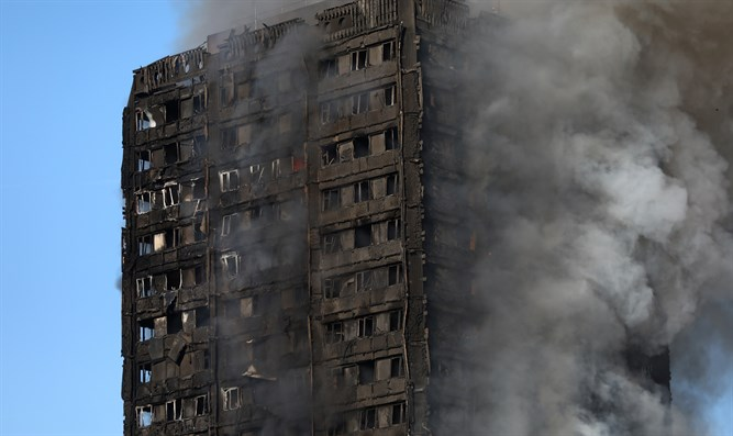 Grenfell Tower apartment building goes up in flames in London