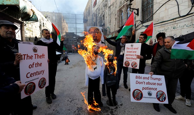 Arab demonstrators protest against Trump peace plan in Hebron, February 28 2020
